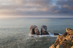 Some rocks in the sea, Cantabric door, Spain. Some rocks in the sea at sunset, Cantabric door, Spain Stock Image
