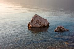 Some rocks on the shore of the lake. Some rocks on the shore of the lake Maggiore royalty free stock image