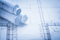Some rolled up construction drawings building and. Architecture concept royalty free stock photo