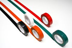 Grand Prix. Some rolls of colored insulating tape on a white surface Stock Photos