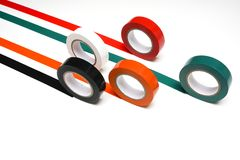 Grand Prix. Some rolls of colored insulating tape on a white surface Stock Image