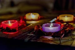 Some romance with candles on a table. Few candles in the table with romantic atmosphere, valentine`s day Royalty Free Stock Image