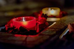 Some romance with candles on a table. Few candles in the table with romantic atmosphere, valentine`s day Royalty Free Stock Images