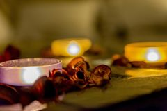 Some romance with candles on a table. Few candles in the table with romantic atmosphere, valentine`s day Stock Photos
