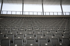 Some rows of gray stadium seats. Shoot from the front stock photography