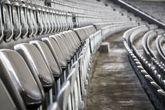 Some rows of gray stadium seats. Shoot from the side royalty free stock photography