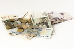 Some russian banknotes and coins on a grey background Royalty Free Stock Photo