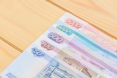 Some Russian money on wooden background Royalty Free Stock Image