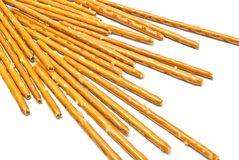 Some salted breadsticks on white. Background closeup Stock Photo