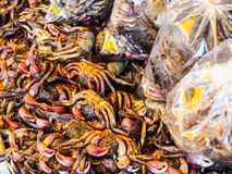 Some salted crab. In hot food bags at Asian market Stock Photos