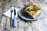 Some sandwiches on the blue plate, horizontal snapshot Stock Photos