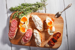 Some sandwiches on white wood background. Some tasty sandwiches on wood background. Top view stock photos