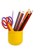 Some scissors and pencils in a cup. Some scissors and color pencils in a cup isolated on the white Stock Images