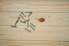 Some screws on the wooden surface. New clean planks of spruce wood with some screws on the surface Royalty Free Stock Photos