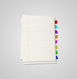 Some sheets from notebook with bookmarks. On grey background Stock Photo