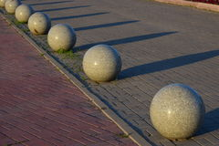 Some shiny stone spheres. As a street decoration Royalty Free Stock Photos