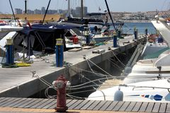 Some ships and boats at a harbour 3. This is a shot of some ships and boats at cape Roig in Orihuela stock images