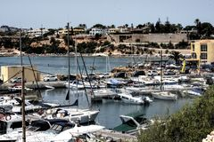 Some ships and boats at a harbour 4. This is a shot of some ships and boats at cape Roig in Orihuela stock image