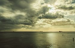 Some ships are staying on anchors at sea under the clouds. In th Indian Ocean Stock Image