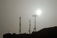 Some Silhouetted Antennas. On the top of a Hill Stock Photography