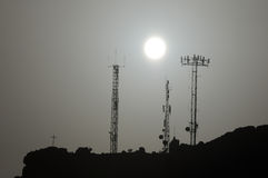 Some Silhouetted Antennas Royalty Free Stock Photo