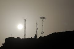 Some Silhouetted Antennas. On the top of a Hill Stock Images