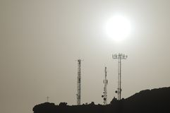 Some Silhouetted Antennas. On the top of a Hill Royalty Free Stock Image