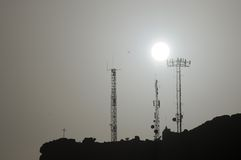 Some Silhouetted Antennas. On the top of a Hill Stock Image