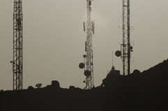 Some Silhouetted Antennas. On the top of a Hill Royalty Free Stock Photography