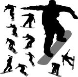 Some silhouettes of snowboarders. In different moments royalty free illustration