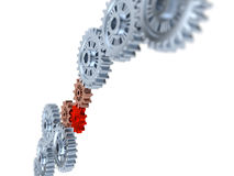Some Silver Gears blurred with one Red Stock Images
