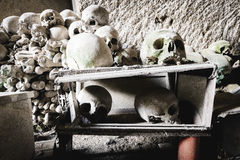 Some skulls piled in Fontanelle cemetery. Royalty Free Stock Photography