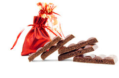 Some slices of black porous chocolate Royalty Free Stock Images