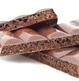 Some slices of black porous chocolate Stock Image