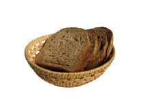 Some slices of bread in the bread-basket. Isolated on white Stock Image