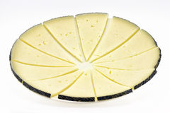 Some slices of manchego cheese. Typical of Spain, isolated on a white background Stock Image