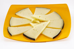 Some slices of manchego cheese. Typical of Spain, isolated on a white background Royalty Free Stock Photography