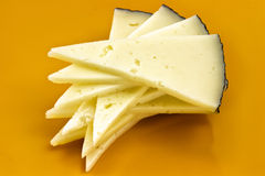 Some slices of manchego cheese. Typical of Spain, isolated on a white background stock photography