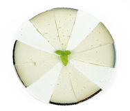 Some slices of manchego cheese. Typical of Spain, isolated on a white background Stock Photos