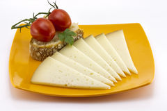 Some slices of manchego cheese from Spain. Bread and tomato Royalty Free Stock Images