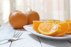 Some slices of natural oranges served on a white wooden table. Empty copy space for editor's text Stock Images