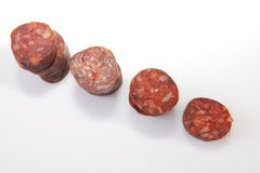 Some slices of red iberian chorizo Royalty Free Stock Photo