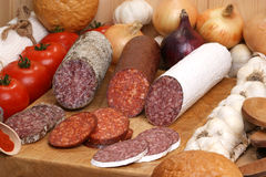 Some slices salami on a timber board Stock Images