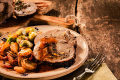 Some slices of stuffed roast with vegetables on a plate Royalty Free Stock Photo