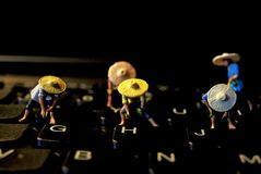 Some smal famer on the keyboard stock photos
