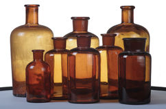 Some small bottles of an ancient drugstore. The transparency of eight bottles produces some new pastel colors that seem to come out of a painter brush stock images