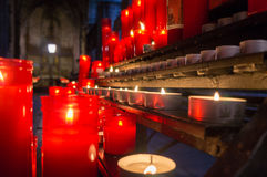 Some small candles burning. Some small candeles burning in a curch Royalty Free Stock Photos