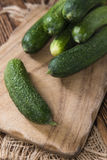 Some small Cucumbers. (close-up shot) on vintage wooden background Royalty Free Stock Photos
