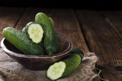 Some small Cucumbers. (close-up shot) on vintage wooden background Royalty Free Stock Images