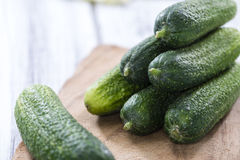 Some small Cucumbers. (close-up shot) on vintage wooden background Royalty Free Stock Photography